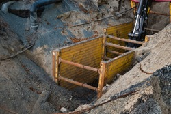 Keeping workers safe during trenching and excavation with safety equipment while doing construction work