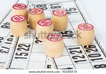 Kegs bingo, against a background of playing cards