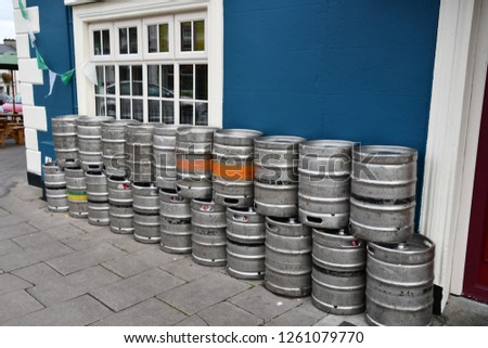 kegs lined up outside pub in ireland.  Bar with keg of beer.