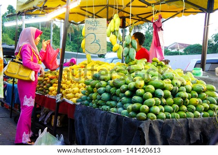 KELANTAN, MALAYSIA-JUN 01: Typical local fruits street market in Kota Bharu on Jun 01, 2013 in Kelantan, Malaysia. Most of the fruits are imported from Thailand
