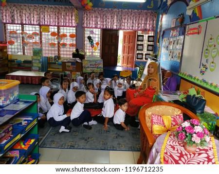 Kelantan ,Malaysia -7 /10/2018:Teacher and kids in a lesson at a pre school #1196712235