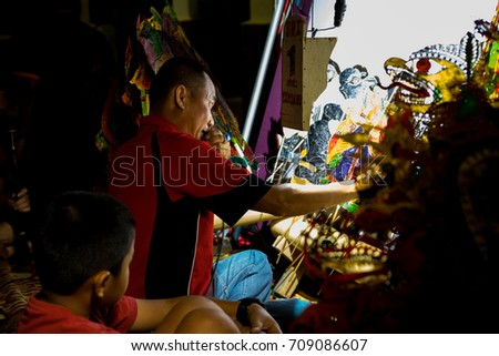 KELANTAN, MALAYSIA - 15TH JULY 2017; Unidentified man make an art demonstration Shadow Puppet  for  tourists in Kota Baharu Kelantan