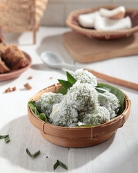 kelepon or klepon or onde-onde made from glutinous rice flour and filled with brownn sugar covered with grated coconut. Some people called this traditional cake from Indonesia as Onde-onde.