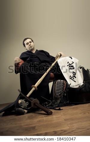 Kendo master portrait with sword - martial art concept - stock photo