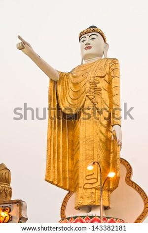 KENGTONG,MYANMAR-APRIL 1 :The pointing Buddha statue at Wat Jom sak temple on April 1,2007 in Kengtong(Kyaing tong) city , Shan state Myanmar.The pointing Buddha posture is very popular in Myanmar.
