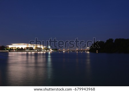 Kennedy center in DC reflection in the Potomac river at night