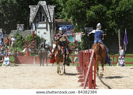 KENOSHA, WI - AUGUST 21: Actors as medieval knights jousting at the annual Bristol Renaissance Faire on August 21, 2011 in Kenosha, WI - stock photo
