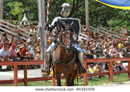 KENOSHA, WI - AUGUST 21: An actor as medieval knight demonstrate skills on horseback at the annual Bristol Renaissance Faire on August 21, 2011 in Kenosha, WI
