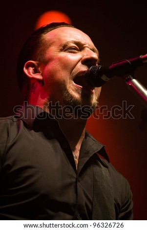 KENT, WA - FEB 21:  Singer and guitar player Michael Poulsen of Danish Heavy Metal rock band Volbeat performs on stage during the Gigantour tour on February 21, 2012  in Kent, Washington.