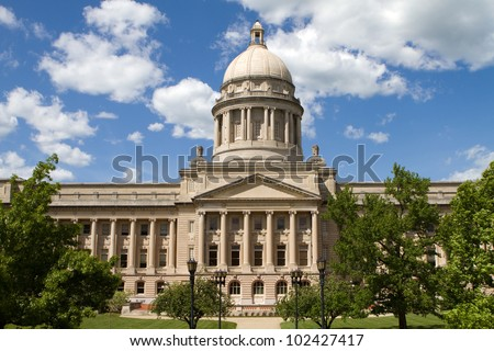 Kentucky State Capitol in Frankfort, Kentucky, USA against a cloud filled blue sky background.