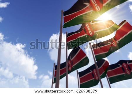 Kenya flags waving in the wind against a blue sky. 3D Rendering