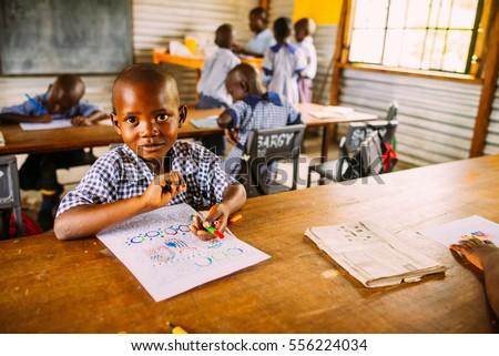 KENYA, RUSINGA island, UTAJO village - OCTOBER 24, 2016: children in a poor african class, school
