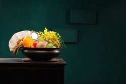 Kerala festival,rituals of Vishu festival -Vishukkani or Vishu sight, a brass vessel  filled with fruits and vegetables mostly  available in summer season,mirror,golden shower flower and new cloth .