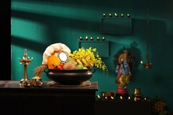 Kerala festival,rituals of Vishu festival -Vishukkani or Vishu sight, a brass vessel filled with fruits and vegetables  and many things arranged  traditionally  infront of lord Krishna statue
