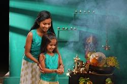 Kerala festival,rituals of Vishu festival -Vishukkani or Vishu sight and two children celebrating Vishu by burning the fire sparkler.