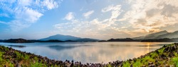 Kerala nature scenery panorama view of banasura sagar dam wayanad, awesome image of biggest earth dam during sunset India travel and tourism concept photo, calm. River with mountains nature scenery