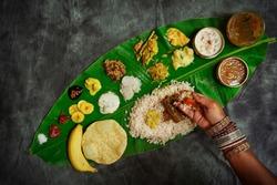 Kerala Onam Feast / Eating Ona-Sadya in banana leaf during the festival of Onam