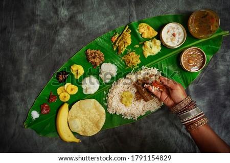 Kerala Onam Feast / Eating Ona-Sadya in banana leaf during the festival of Onam Zdjęcia stock ©