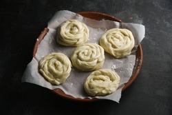 Kerala paratha porotta roti. Making preparing of dough Indian flatbread bakery products. Maida or wheat flour Cooking the dough.  Malabar parotta barotta is Indian layered flatbread, street food snack