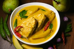 Kerala style King or Barracuda fish curry with coconut milk mild spicy seafood cuisine Kerala , India. Rice and fish is a popular delicious recipe in the Indian coastal area restaurant.