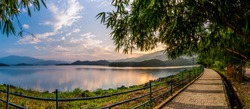 Kerala Tourism Image Largest Earth Dam in India Banasura Sagar Dam Wayanad, beautiful sunset view through mountains with bamboo trees colorful nature scenery from God's own country