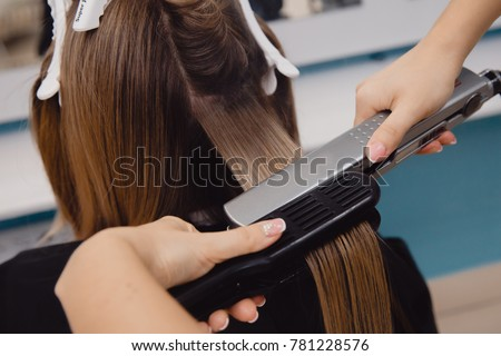 Keratin recovery hair and protein treatment pile with professional ultrasonic iron tool. Concept lamination, lifting