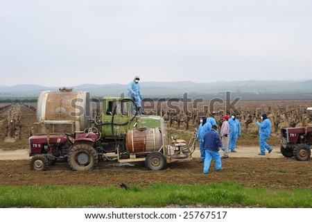 KERN COUNTY, CA - FEB 27: Farm workers load chemicals to spray on vineyards on February 27, 2009 in Kern County, CA. Chemicals are used to reduce insect damage to crops in area.
