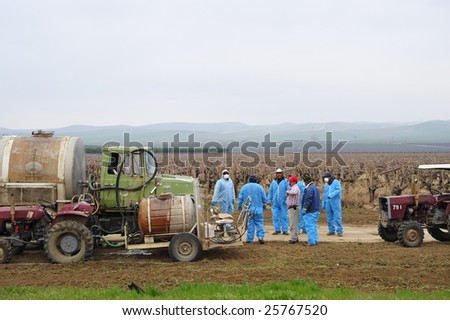 KERN COUNTY, CA - FEB 27: Farm workers prepare to load chemicals to spray on vineyards on February 27, 2009 in Kern County, CA. Chemicals are used to reduce insect damage to crops in area.