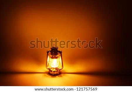 Kerosene lamp illuminated, concept gold lighting