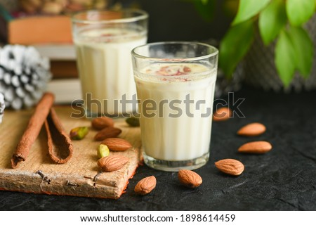 Kesar Badam milk shake or Almond Saffron milk prepared with almonds, spices and milk Kerala India. Kheer or North Indian traditional health drink Flavoured milk badam lassi served with dry fruit