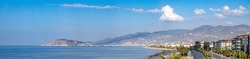 Kestel neighborhood, Alanya, Antalya Province, Turkey panorama with highway road by coastline, cycling road and view into city of sunny Alanya in the Mediterranean region of Turkey