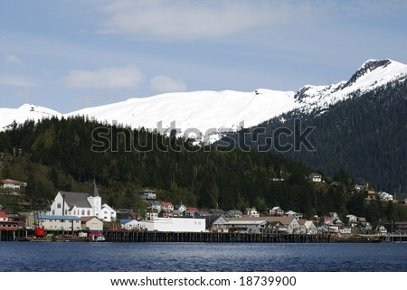 Ketchikan city skyline with snow-covered mountains in a background (Alaska).