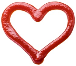 Ketchup in a shape of heart on white background. File contains clipping path.