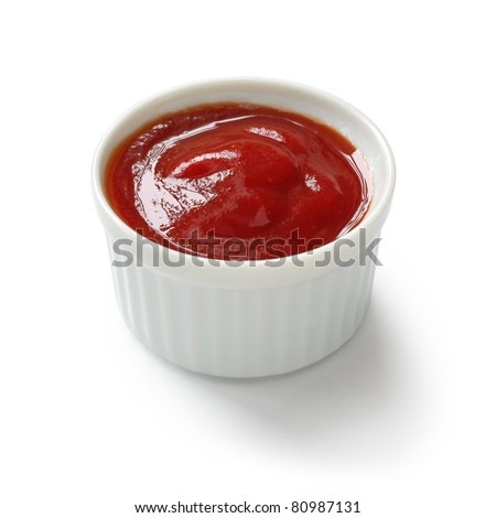 ketchup in ramekin on white background