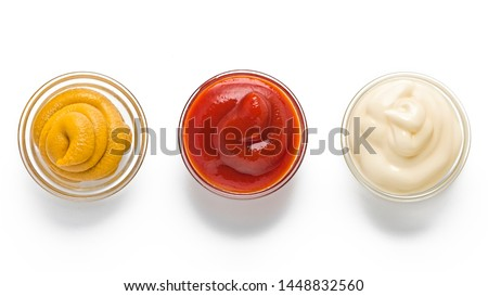 ketchup, mustard, mayonnaise in glass bowls on a white background. Traditional fast food and barbecue sauces. Foto d'archivio ©