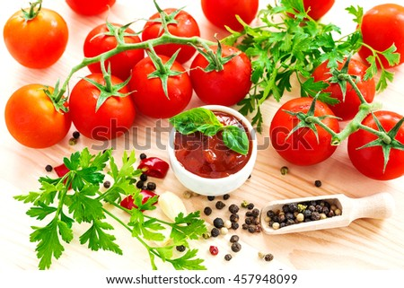 Ketchup. Tomato sauce salsa, hot chili, parsley, fresh tomatoes on vine, garlic, and spices, allspice, on wooden background. ingredients. Top view #457948099