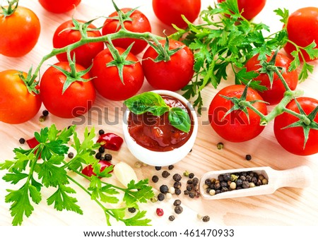 Ketchup. Tomato sauce salsa, hot chili, parsley, fresh tomatoes on vine, garlic, and spices, allspice, on wooden background. ingredients. Top view #461470933