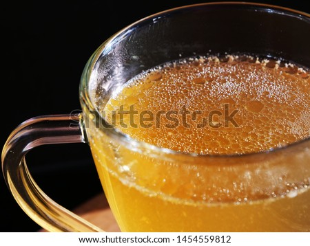 Keto bone broth in glass mug over black background. Homemade ketogenic energy drink, no-carb, high fat superfood with essential minerals. Сток-фото ©