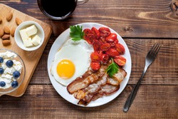 Keto food: eggs, avocado, bacon, butter, etc. Healthy fast concept.