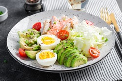 Ketogenic diet, breakfast. Eggs, fish and avocado, lettuce and seeds. Low carb high fat breakfast. Keto/paleo menu.