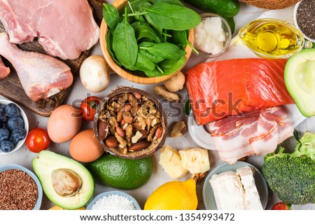 Ketogenic diet food. Healthy low carbs products. Keto diet concept. Vegetables, fish, meat, nuts, seeds, berries, cheese. top view #1354993472