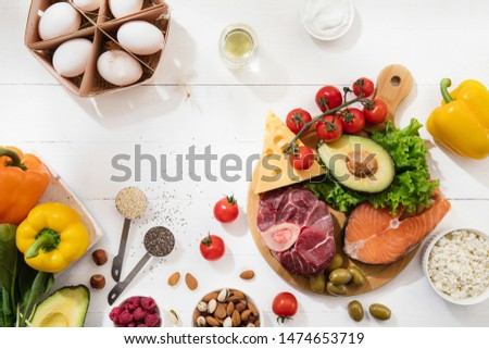 Ketogenic low carbs diet - food selection on white wooden background. Balanced healthy organic ingredients of high content of fats. Nutrition for the heart and blood vessels. Meat, fish and vegetables #1474653719