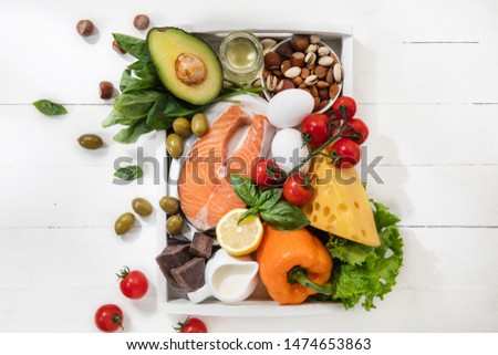 Ketogenic low carbs diet - food selection on white wooden background. Balanced healthy organic ingredients of high content of fats. Nutrition for the heart and blood vessels. Meat, fish and vegetables #1474653863