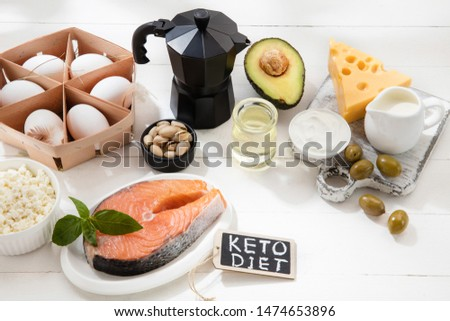 Ketogenic low carbs diet - food selection on white wooden background. Balanced healthy organic ingredients of high content of fats. Nutrition for the heart and blood vessels. Meat, fish and vegetables #1474653896