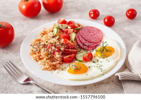 ketogenic paleo diet breakfast. cauliflower rice, fried egg salami #1557796100