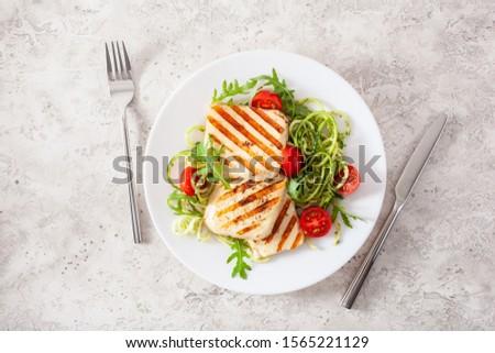 ketogenic paleo diet lunch. halloumi cheese, spiralized zucchini with arugula pesto and tomatoes #1565221129