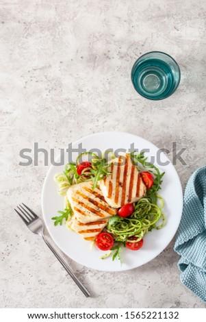 ketogenic paleo diet lunch. halloumi cheese, spiralized zucchini with arugula pesto and tomatoes #1565221132