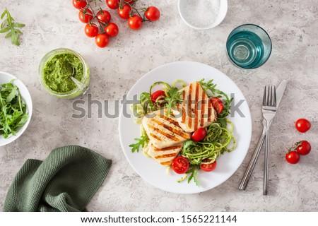 ketogenic paleo diet lunch. halloumi cheese, spiralized zucchini with arugula pesto and tomatoes #1565221144