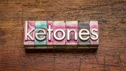 ketones word abstract in gritty vintage letterpress metal type stained by printing ink against rustic wood, keto diet concept
