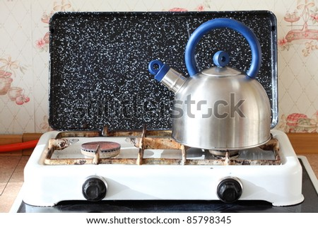 kettle and gas cooker on modern kitchen